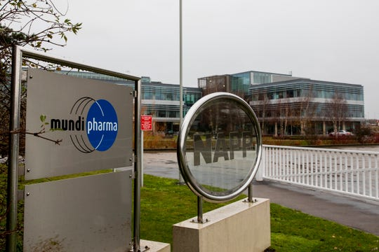 This Dec. 12, 2019, photo shows a sign at the Mundipharma International headquarters at Cambridge Science Park in England. Mundipharma is the international affiliate of Purdue Pharma, the maker of the blockbuster painkiller OxyContin. Mundipharma is now marketing Nyxoid, a new brand of naloxone, an opioid overdose reversal medication.