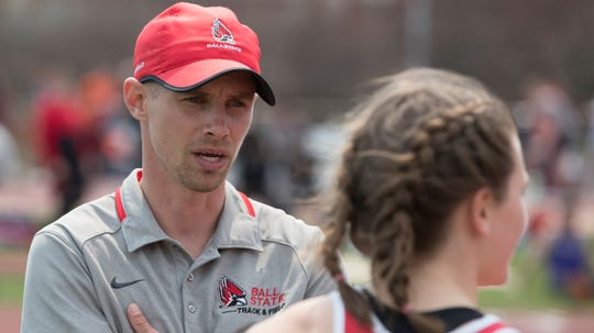 BSU coach Brian Etelman speaks with an athlete during a competition prior to the 2019-20 season. Etelman is in his fifth year leading the Cardinals.