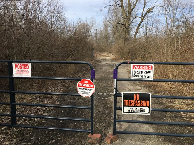 Kathleen Michelle Mills and Richard Hawk of Anderson have put a stop to open dumping on a nine-acre brushy site at 1000 N. Claypool Road in Muncie.