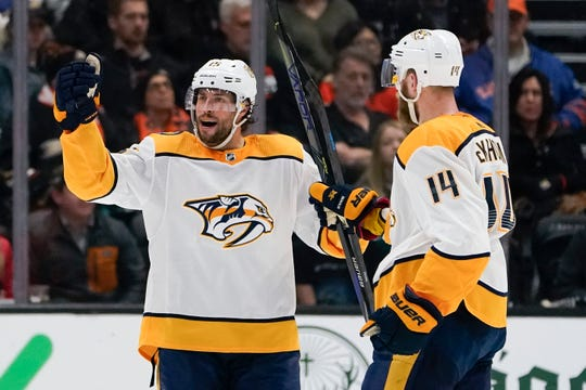 Nashville Predators right wing Craig Smith, left, celebrates after his goal with Mattias Ekholm during the second period of an NHL hockey game against the Anaheim Ducks in Anaheim, Calif., Sunday, Jan. 5, 2020. (AP Photo/Chris Carlson)