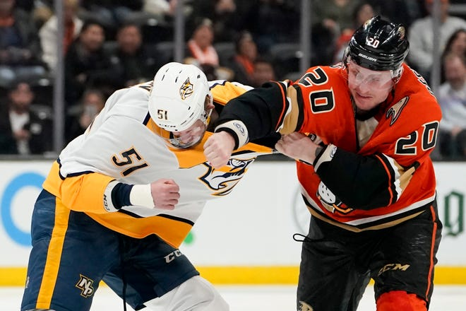 Anaheim Ducks left wing Nicolas Deslauriers, right, fights with Nashville Predators left wing Austin Watson during the first period of an NHL hockey game in Anaheim, Calif., Sunday, Jan. 5, 2020.