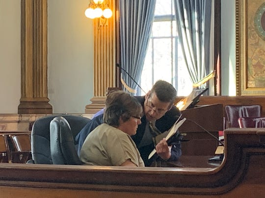 Attorney Robert Calesaric speaks to his client, Laura VanScoy-Andrews, moments after a Licking County judge granted their motion for judicial release on Monday, Jan. 6, 2020. Former Alexandria treasurer VanScoy-Andrews was sentenced to prison after being found guilty of stealing money from the village in 2017.