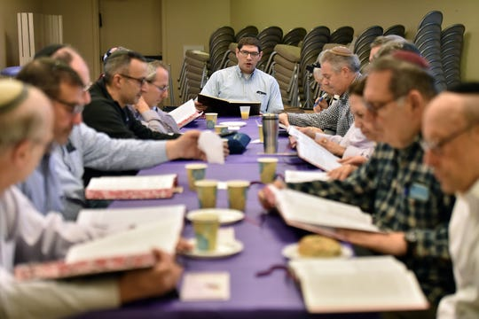 Eliezer Gross leads a daf yomi group at Congregation Keter Torah as they study a page of the Talmud on Sunday morning, December 29, 2019. For almost seven and a half years straight, Jews around the world have been reading the Talmud, cover to cover, a page at a time.