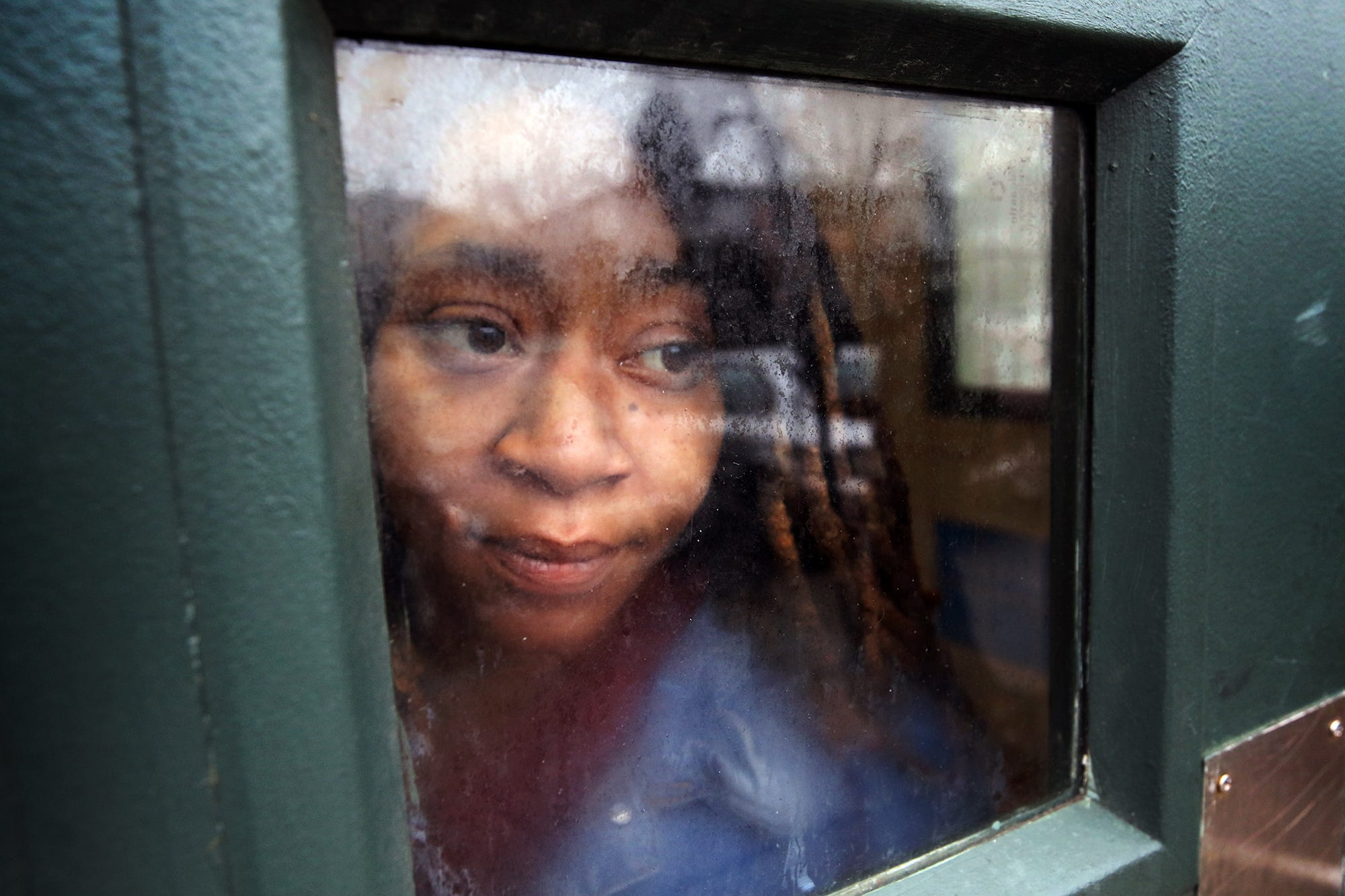 Tiffany Taylor stares out a window in her Jersey City apartment building during a recent interview.