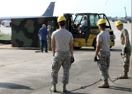 Airmen from the 752nd Operations Support Squadron unload the AN/TYQ-23A Tactical Air Operations Module weapons system as it arrives at Tinker Air Force Base, Okla. in September 2019. The ground-based weapons system allows squadron members at Tinker AFB to provide command and control to both live and simulated aircraft from around the country and is one of only four active-duty bases to obtain the equipment.