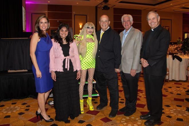 """Attendees at last season's Desert Arc """"Champions of Change"""" Recognition Awards Luncheon included Brooke Beare, event emcee and board chair of Desert Arc; Desert Arc client of the year, Veronica; Honorees Karen and Tony Barone; Richard Balocco, President-CEO of Desert Arc, and Honoree Reverend Monsignor Howard A. Lincoln."""