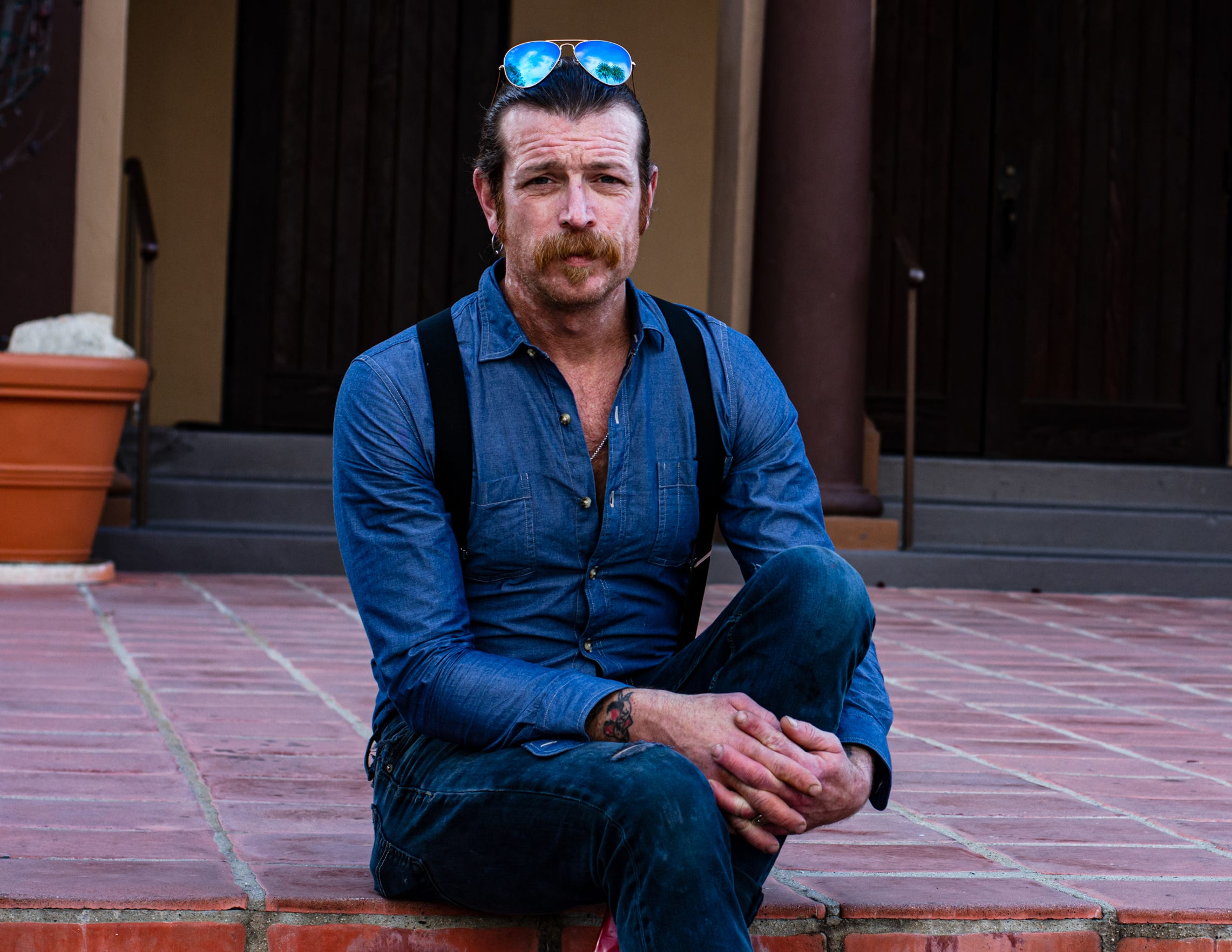 Jesse Hughes poses on the steps of the Holy Trinity Catholic Church in Los Angeles, Calif. on Dec. 19, 2019.