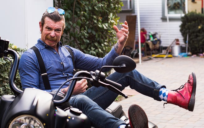 Jesse Hughes of Eagles of Death Metal poses on his motorcycle in Los Angeles, Calif. on Dec. 19, 2019.