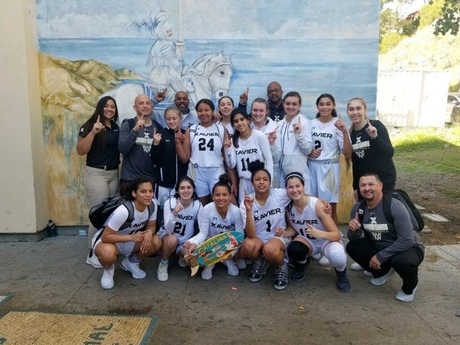 The girls' basketball team at Xavier Prep poses for a picture after winning the Avalon Tournament on Jan. 4, 2020.