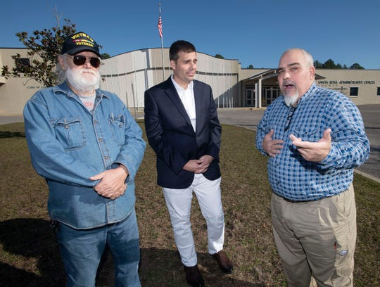 Sam Mullins, right, shares his plans for an upcoming Second Amendment rally with Wayne Smyly, left, and James Calkins, center, outside the Santa Rosa County Administrative Complex on Monday. The three men are helping to organize the Jan. 18 event, where they will be passing out militia cards and informing people of the Second Amendment rights.