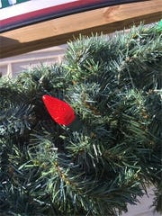 'Keep the Wreath Green' fire safety campaign ends with one red bulb.