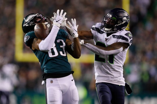 Philadelphia Eagles' Shelton Gibson, left, cannot catch a pass against Seattle Seahawks' Tre Flowers during the second half of an NFL wild-card playoff football game, Sunday, Jan. 5, 2020, in Philadelphia. Flowers was called for pass interference.
