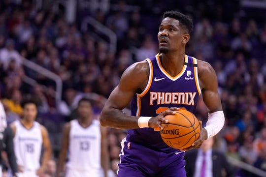 Phoenix Suns center Deandre Ayton (22) in the first half during an NBA basketball game against the Memphis Grizzlies, Sunday, Jan. 5, 2020, in Phoenix. (AP Photo/Rick Scuteri)