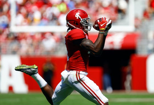 Alabama Crimson Tide wide receiver Jerry Jeudy (4) is a trendy pick for the Arizona Cardinals in the 2020 NFL draft.