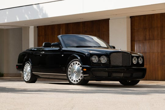 Simon Cowell will auction off a triple-black 2009 Bentley Azure Convertible. The car is powered by a 6.75-liter V8 engine backed by an automatic transmission and will be auctioned off on Saturday, Jan. 18.