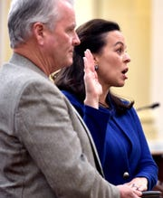 York County Commissioner Julie Wheeler recites the oath of office with her husband Michael while being sworn in for her first term during a ceremony at the York County Administrative Center Monday, Jan. 6, 2020. The York County Commissioners took the oath of office, along with York County Treasurer Barbara Bair. Bill Kalina photo