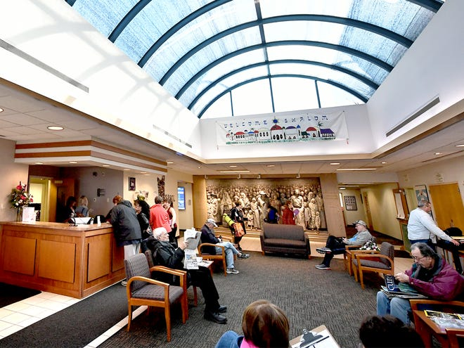 Visitors occupy the entryway at the Jewish Community Center Monday, Jan. 6, 2020. The center is applying for grants to secure the area. Bill Kalina photo