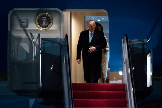 President Donald Trump and first lady Melania Trump exit Air Force One, Sunday, Jan. 5, 2020, at Andrews Air Force Base, Md., following a trip to his Mar-a-Lago estate. (AP Photo/Kevin Wolf)