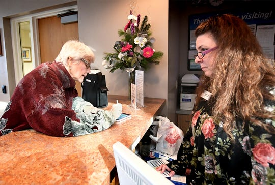 Ruth Fronczak of Dallastown, left, is helped by Jewish Community Center associate Charlene Peters at the reception desk Monday, Jan. 6, 2020. Fronczak recently became a member there. The center is applying for grants to secure the entryway to the facility. Bill Kalina photo