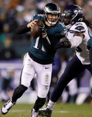 Philadelphia Eagles quarterback Josh McCown, left, tries to get past Seattle Seahawks defensive lineman Jadeveon Clowney on Sunday. (AP Photo/Matt Rourke)