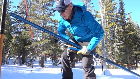 Jeff Anderson, hydrologist for the Natural Resources Conservation Service, gathers tools to measure snowpack at Slide Mountain near Reno on Jan. 6, 2020.