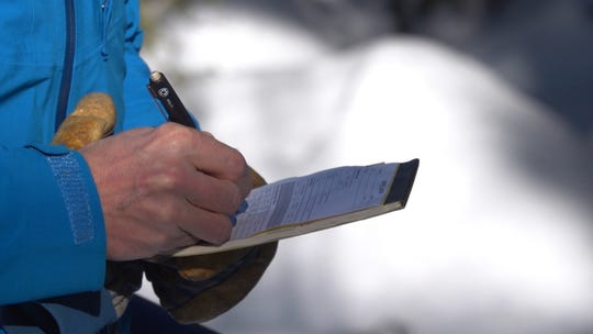Jeff Anderson of the Natural Resources Conservation Service records snowpack measurement findings on Slide Mountain near Reno on Jan. 6, 2020.
