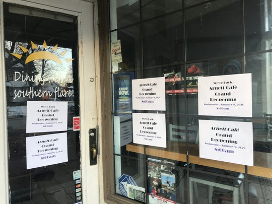Signs in its window indicate that the Arnett Cafe will reopen Jan. 8.