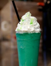 A blended green apple and blue raspberry Red Bull drink at Brotherhood Coffee.
