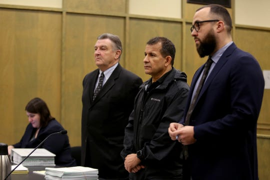 Oscar Tejeda-Sandoval, 52, stands between his attorneys Paul Ferder, left, and Zachary Stern as prosecutor Sarah Shepherd sits near by while Tejeda-Sandoval pleads guilty to 10 counts of theft, identity theft, aggravated theft and aggravated identity theft at the Polk County Courthouse in Dallas on Jan. 6, 2020. The Salem mortgage consultant is alleged to have stolen almost $80,000 from his clients throughout the Willamette Valley.