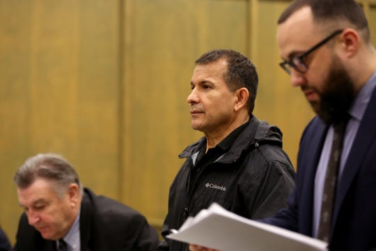 Oscar Tejeda-Sandoval, 52, stands between his attorneys Paul Ferder, left, and Zachary Stern while pleading guilty to 10 counts of theft, identity theft, aggravated theft and aggravated identity theft at the Polk County Courthouse in Dallas on Jan. 6, 2020. The Salem mortgage consultant is alleged to have stolen almost $80,000 from his clients throughout the Willamette Valley.
