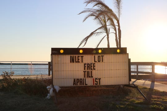 A lightboard by the Oceanic Motel on Baltimore Avenue informs passing motorists that parking in the Ocean City Inlet is free until April 1.