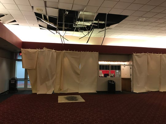 A photo of the damage caused by Sunday's fire at West Mall 7. A rooftop unit caught fire, causing damage to the ceiling and floor of the theater.