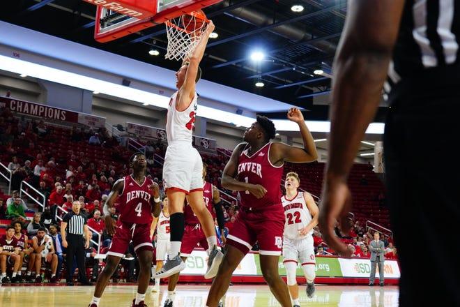 South Dakota's Tyler Hagedorn dunks the ball against Denver on Sunday, Jan. 5 in Vermillion.