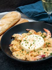 Creamy Cajun Shrimp and Boursin Grits gets extra flavor from smoked Gouda in the grits.