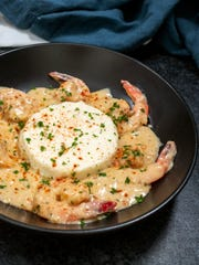 Shrimp and grits was traditionally served for breakfast in areas with abundant local shrimp.