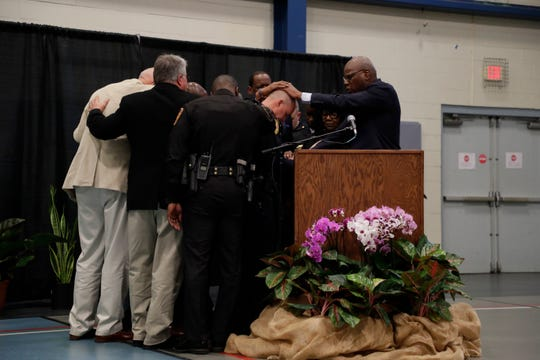 Local clergy pray over newly-appointed Tallahassee Police Chief Lawrence Revell at his swearing-in ceremony at Jack McLean Community Center Monday, Jan. 6, 2020.