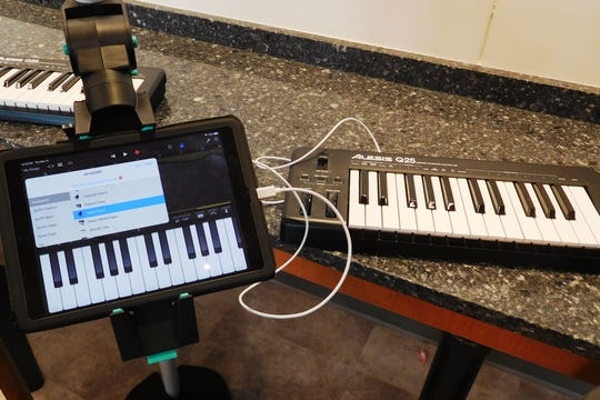 A MIDI setup ready for musical exploration by HCES students .
