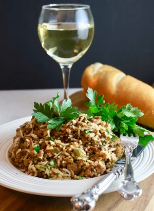 Dirty rice pairs well with a glass of wine and french bread.