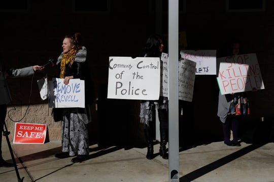 Protestors express disapproval of the appointment of Lawrence Revell as police chief of the Tallahassee Police Department to TV journalists outside his swearing-in ceremony at Jack McLean Community Center Monday, Jan. 6, 2020.
