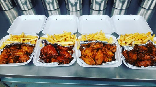 JammBar Wings has signature sauces including kickin' bourbon, mango habanero, sweet red chili and tangy gold.