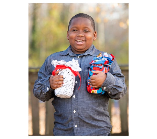 Christian Paul, 8, has started his own business, Jars With Many Meanings.
