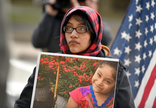 The mother of missing 5-year-old Dulce Alavez, Noema Alavez Perez, holds a photo of her daughter at Bridgeton City Hall on Monday, Jan. 6, 2020.