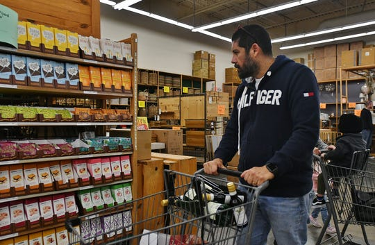 """Frequent World Market customer Emilio Montti stocks up on imported wine and beer at World Market ahead of its announced Jan. 25 closure. The Salvadorian immigrant says he's """"in denial"""" about one of his favorite Visalia stores closing."""