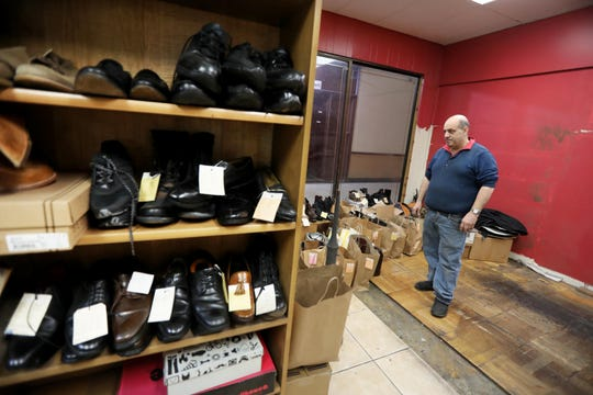 Paul Chillemi, owner of Chillemi Shoe Repair located in the White Plains Mall, surveys his remaining inventory Jan. 6, 2019. Chillemi is finishing packing up his business and moving to a location at 95 Church St. in White Plains. The White Plains Common Council has announced plans to tear down the mall, photographed Jan. 6, 2020, and replace it with a development called Hamilton Green, which is to include commercial and residential space. The plan has been stalled as the site plan approval for the property has expired.