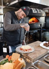 Chef Christian Petroni of Fortina and Food Network prepares his new plant-based chicken Parmesan Jan. 6, 2020 in Yonkers. Fortina is also adding plant-based meatballs to the menu.