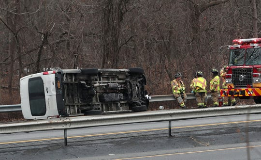 Goldens Bridge firefighters await the arrival of a tow truck following a two-vehicle accident on southbound I-684 just south of Route 138 in Goldens Bridge Jan. 6, 2020. The driver of the van suffered a serious hand injury and was transported to the hospital by Katonah/Bedford Hills Ambulance Corps. Traffic southbound was backed up for miles.