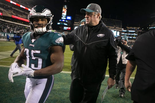 Eagles head coach Doug Pederson, right, puts his arm around running back Boston Scott (35) after losing to the Seattle Seahawks 17-9 Sunday night at Lincoln Financial Field.