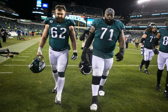 Philadelphia's Jason Kelce (62) and Jason Peters (71) hang their heads as they head towards the locker room tunnel after losing to the Seattle Seahawks 17-9 in January.