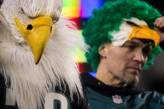 Eagles fans hang their heads during Philadelphia's 17-9 loss to the Seattle Seahawks Sunday night at Lincoln Financial Field.