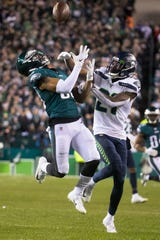 Eagles' Shelton Gibson watches a pass come in as he is fouled by Seattle's Marquise Blair (27) Sunday night at Lincoln Financial Field. The Seahawks defeated the Eagles 17-9.